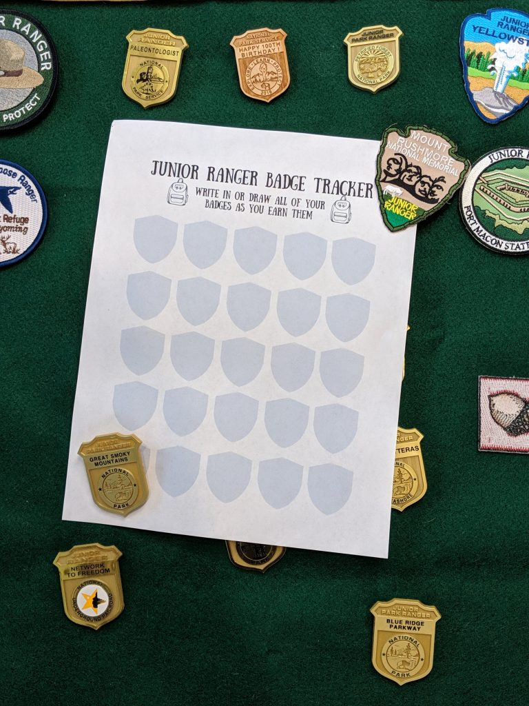 free junior ranger badge tracker printable to use in your homeschool. Track the national parks you visited with this free printable. Become a Junior Ranger and earn badges. Rabbit Trails through the Parks.